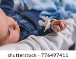 baby with a nipple. close up of ... | Shutterstock . vector #776497411