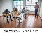 school lesson with teacher and... | Shutterstock . vector #776517649