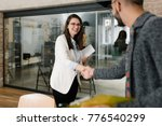 openly greeting a job recruiter ... | Shutterstock . vector #776540299