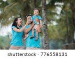asian family of three having... | Shutterstock . vector #776558131