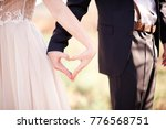 bride and groom making heart by ... | Shutterstock . vector #776568751