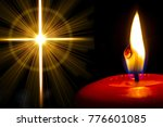 A Red Candle Shines Next To A...
