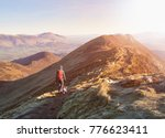 a hiker and their dog walking... | Shutterstock . vector #776623411