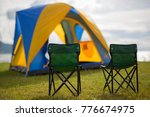 two chairs on the green grass...   Shutterstock . vector #776674975