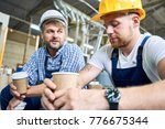 portrait of two workers wearing ... | Shutterstock . vector #776675344