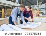 portrait of two workmen... | Shutterstock . vector #776675365