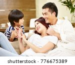 asian mother father and son... | Shutterstock . vector #776675389
