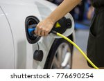 hand holding electric car... | Shutterstock . vector #776690254