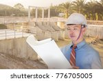 Asian male engineer working in dam construction project