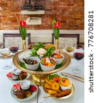 Small photo of Thai food sampler with main dishes, entrées, desserts, red and white wine