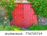 a vintage red door with horse... | Shutterstock . vector #776735719