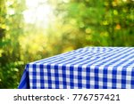 empty checkered table background | Shutterstock . vector #776757421