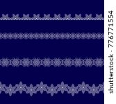 set of white lace ribbons on a... | Shutterstock .eps vector #776771554