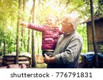 grandfather with granddaughter... | Shutterstock . vector #776791831