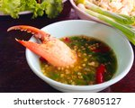 crab meat in seafood sauce | Shutterstock . vector #776805127