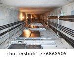 elevator in lift shaft | Shutterstock . vector #776863909