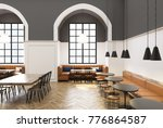 Stock photo modern cafe interior with white and gray walls a wooden floor round gray and long wooden tables 776864587