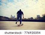 female skateboarder riding with ... | Shutterstock . vector #776920354