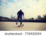 female skateboarder riding with ... | Shutterstock . vector #776920354