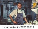smiling cook in uniform indoors | Shutterstock . vector #776923711