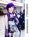 Small photo of Birmingham, UK - November 18, 2017: Cosplayers dressed as Kyoka Jirou from the anime My Hero Academia at Birmingham MCM Comic Con.