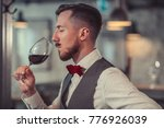 young man tasting wine | Shutterstock . vector #776926039