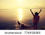 young woman with raised hands... | Shutterstock . vector #776928385