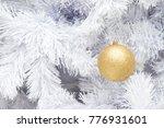 gold ball on white branch of... | Shutterstock . vector #776931601