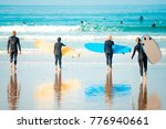 surf beginners going to surf  | Shutterstock . vector #776940661
