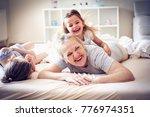 grandmother enjoying in bed...   Shutterstock . vector #776974351