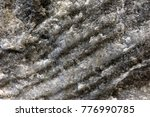 Small photo of Natural Salt Wall Background Pattern in a Mine, alternating Layers of Pure Salt with Sand