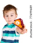 The little boy gives the toy house - stock photo