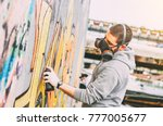 street artist painting colorful ...