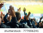 Small photo of Football fans clapping on the podium of the stadium