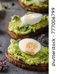 Small photo of Bio avocado on bread with boiled egg, delish food