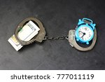handcuffs  money and alarm... | Shutterstock . vector #777011119