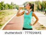 Young woman is drinking water...