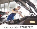 auto mechanic working in garage.... | Shutterstock . vector #777022795