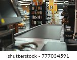 empty cashier checkout place at ... | Shutterstock . vector #777034591