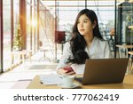 overworked businesswoman... | Shutterstock . vector #777062419