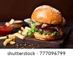 tasty hamburger and french... | Shutterstock . vector #777096799