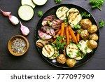 baked vegetables on dark... | Shutterstock . vector #777097909