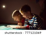 two happy siblings reading book ... | Shutterstock . vector #777121069