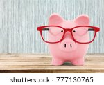 piggy bank qith red glasses | Shutterstock . vector #777130765