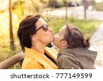 mother and daughter showing... | Shutterstock . vector #777149599