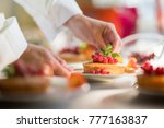 close up on the hands of the... | Shutterstock . vector #777163837