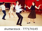 young smiling people practicing ... | Shutterstock . vector #777174145