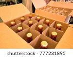 wine bottles in a carton box... | Shutterstock . vector #777231895