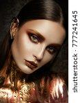 gold woman skin. beauty fashion ...   Shutterstock . vector #777241645