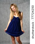 young woman in navy blue dress...   Shutterstock . vector #77724250